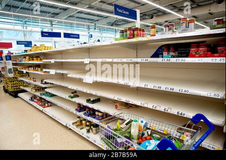 Tesco Supermarket, Hove, U.K., March 2020. Panic buying due to fears of coronavirus has emptied shelves of products such as pasta and toilet rolls.