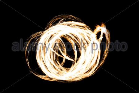 Light painting with beautiful fire in form of rings with a extraordinary pattern - Stock Photo