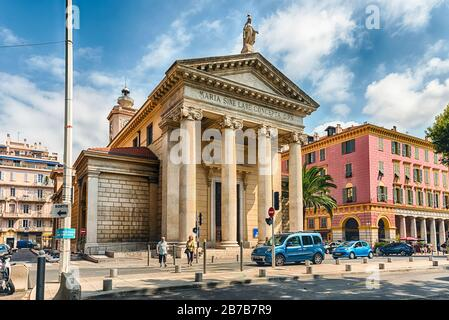 NICE, FRANCE - AUGUST 11: Facade of the Church of Notre-Dame du Port, Nice, Cote d'Azur, France, on August 11, 2019. The Church is located right in fr - Stock Photo
