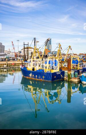 Boats moored in Camber Quay (The Camber), the ancient port in Old Portsmouth, Hampshire, south coast England - Stock Photo