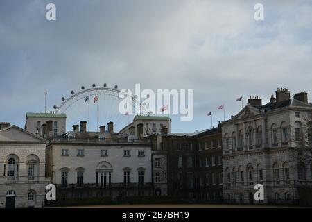 The courtyard at the Horse guard with a view on the London Eye on a cloudy day - Stock Photo