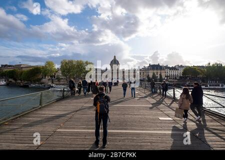 Pont des Arts bridge over the river Seine with the Académie française - French Academy in the background, Paris, France, Europe - Stock Photo