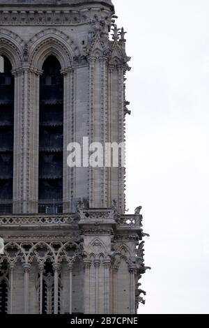 Close up of the right tower of the Notre Dame cathedral in Paris, France, Europe - Stock Photo