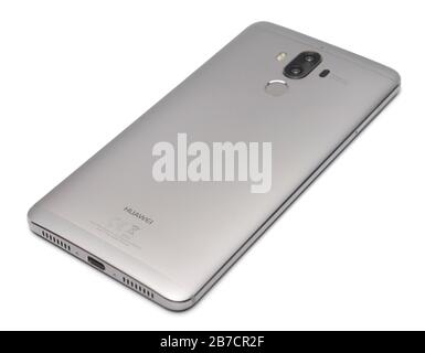 Rear view of a Huawei Mate 9 smartphone with dual camera lenses and a fingerprint scanner cut out isolated on white background - Stock Photo