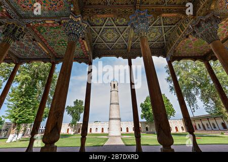 Wooden pillars and minaret of the Jami Mosque known also as Juma Mosque, in Kokand, Uzbekistan. - Stock Photo