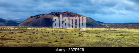 Volcanic landscape in Lanzarote island. Fields of lava.Timanfaya National Park. Canary Islands.Spain. - Stock Photo