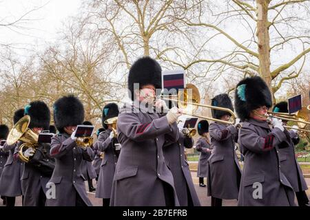 Soldiers & Band Parade Along Birdcage Walk & Horse Guard Road, Tourists Watch - Stock Photo