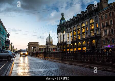 SAINT PETERSBURG, RUSSIA - JULY 15, 2016: Night Griboedov emb with a silhouette of the home of 'Singer' on background, St. Petersburg, Russia - Stock Photo