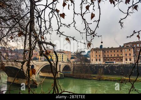 Winter scenery in Rome city with view of Tiber river through the branches. Rome, Italy, Europe - Stock Photo