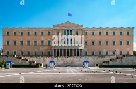 Athens / Greece - March 15 2020: The yard in front of the Greek parliament,  one of the most popular tourist destination is empty of people, due to th - Stock Photo
