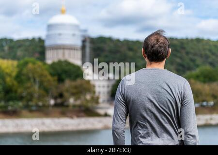 Charleston, West Virginia capital city with back of man looking at scaffold construction on state capitol dome - Stock Photo