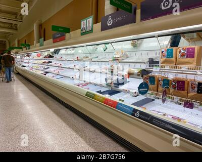 Orlando, FL/USA-3/14//20: Empty meat counter shelves at a Publix grocery store due to the people panicing and hoarding paper and food products. - Stock Photo
