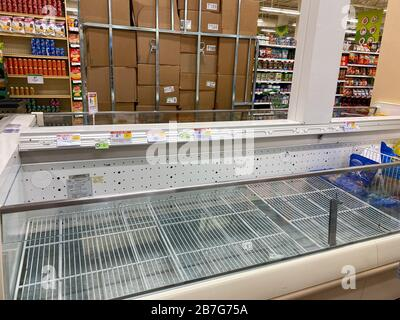 Orlando, FL/USA-3/14//20: Empty chicken display shelves at a Publix grocery store due to the people panicing and hoarding paper and food products. - Stock Photo