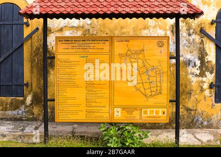 South Asia Sri Lanka Fort Galle colonial town centre ancient harbour port guide map sign of old town & fortifications World Heritage Site town wall - Stock Photo