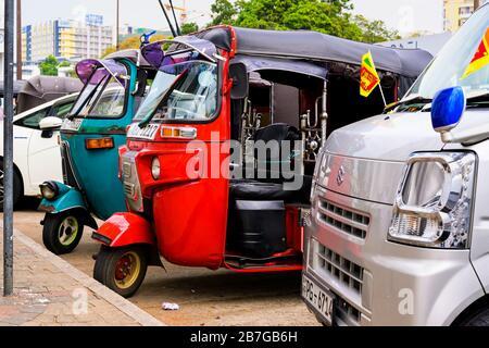 South Asia Sri Lanka Capital City Colombo 7 Deans Street metered tuk tuk taxi cab public transport tree billboard wall high-rise skyscraper