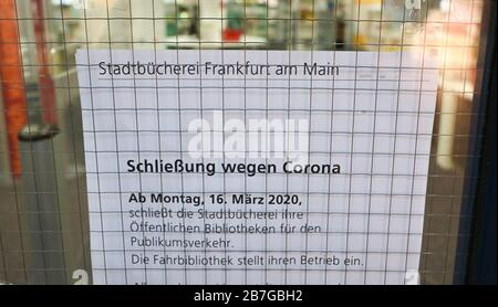 16 March 2020, Hessen, Frankfurt/Main: 'Closure due to Corona' is written on an information sheet attached to the door of the public library in the Saalbau Bornheim. The public libraries are initially closed until 19 April 2020. Photo: Arne Dedert/dpa - Stock Photo