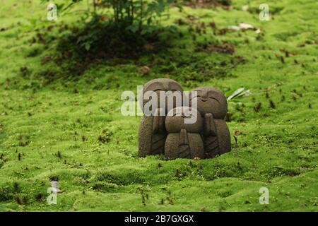Small jizo buddhist statues in the moss (Shisen-do temple in Kyoto) - Stock Photo
