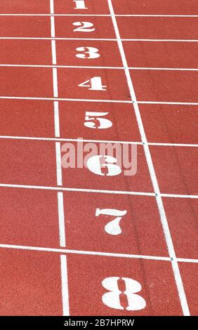 numbers from one to eight of the athletics track lane - Stock Photo