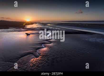 Sunset over the Loughor estuary - Stock Photo