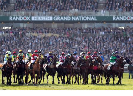 File photo dated 14-04-2018 of Runners and riders at the start of the Randox Health Grand National Handicap Chase. Issue date: Monday March 16, 2020. The 2020 Randox Health Grand National will not take place on April 4 because of the coronavirus pandemic. See PA story RACING Grand National. Photo credit should read David Davies/PA Wire. - Stock Photo