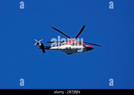 Ornge helicopter air ambulance, in use of transporting paitent in critical conditions, flying in blue sky over Toornto, Ontario,Canada on March 15, 20 - Stock Photo
