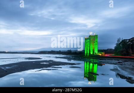 Great Island, Cork, Ireland. 17th March, 2020. Bevelly Castle on the Great Island,  illuminated in green to celebrate St. Patrick's Day outside Cobh, Co. Cork, Ireland. - Credit; David Creedon / Alamy Live News - Stock Photo