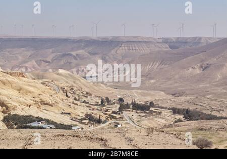 Wind turbines producing electricity on top of a hill in Jordan near the town of Shobak - Stock Photo