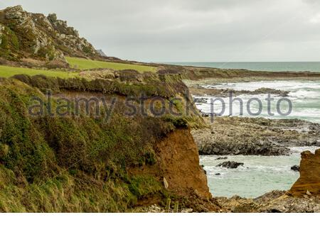 Coastal erosion on the South West Coast Path; Prawle Point looking east towards Start Point. - Stock Photo