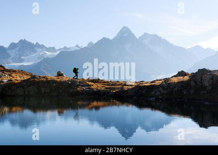Amazing view on Monte Bianco mountains range with tourist on a background. Lac de Cheserys lake, Chamonix, Graian Alps. Landscape photography - Stock Photo