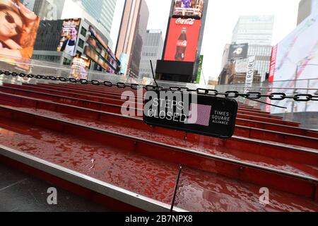 New York City, USA. 17th Mar, 2020. The TKTS Red Steps remain closed to the public in a nearly Times Square due to the coronavirus (Covid-19) pandemic, New York, NY, March 17, 2020. New York Gov. Andrew Cuomo and New York City Mayor Bill de Blasio have put severe restrictions in place such the banned gatherings of 50 or more people, ordered the closing of restaurants, bars, gyms and theatres to stop the spread of the virus through social contact. (Anthony Behar/Sipa USA) Credit: Sipa USA/Alamy Live News - Stock Photo