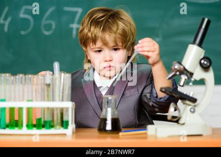 biology science. Little boy is making science experiments. little boy at lesson. Back to school. school kid scientist studying science. science experiments with microscope in lab. Testing your blood. - Stock Photo