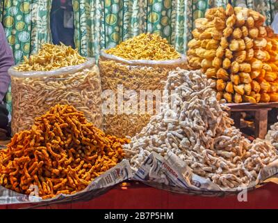 Close up view of different types of Indian namkeen and savory snacks selling on the market. - Stock Photo