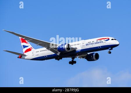 March 13, 2020 San Jose / CA / USA - British Airways Boeing 787 Dreamliner approaching Norman Y. Mineta San Jose International Airport after a direct - Stock Photo