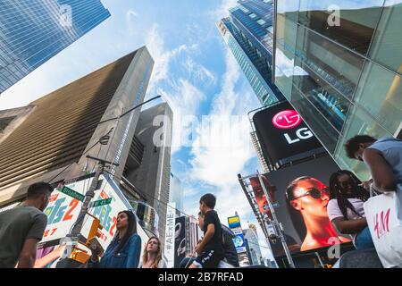 new York City/USA - May 24, 2019  Crowded Times Square, one of the world's most visited tourist attractions. Street view, architecture, bright billboa