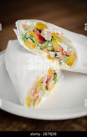 crab mayonnaise and salad wrap on wooden table background - Stock Photo