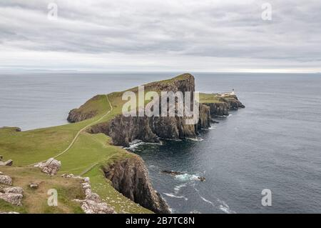 Beautiful panorama of Neist Point lighthouse from Neist Cliff viewpoint - Stock Photo