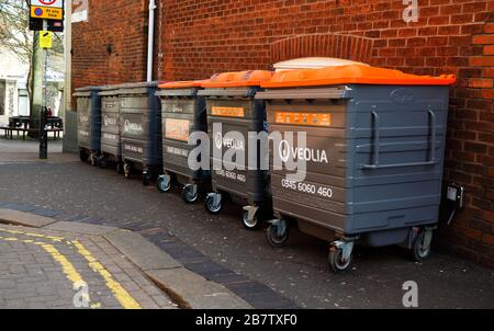 Waste bins outside commercial premises in the centre of the city of Norwich, Norfolk, England, United Kingdom, Europe. - Stock Photo
