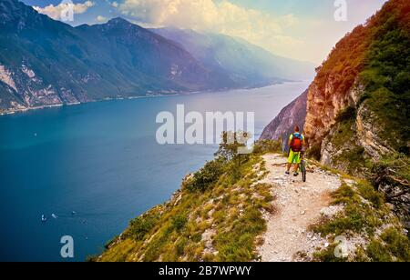 Panoramic view of the beautiful Lake Garda and Riva del Garda town in the summer time , Trentino Alto Adige region,Italy - Stock Photo