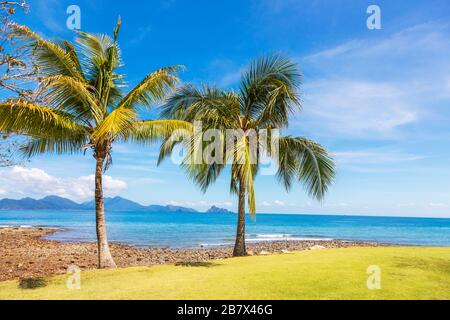 View across the Andaman Sea and  Anak Datai Island from the 16th putting green at the Rainforest Golf Course, The Els Club, Teluk Datai, Langkawi, - Stock Photo