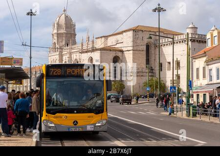 Lisbon, Portugal - 2 March 2020: Passengers boarding a Carris Bus at in the Belem district - Stock Photo