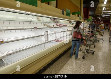 Orlando, FL/USA-3/14//20: Empty meat display shelves at a Publix grocery store due to the people panicking and hoarding paper and food products. - Stock Photo