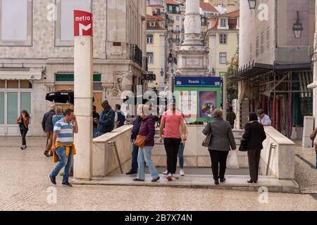 Lisbon, Portugal - 8 March 2020: Passengers entering and leaving Rossio subway station - Stock Photo