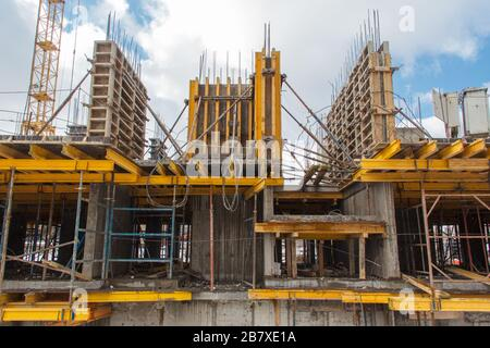 Concrete formwork during the construction of a new building. Reinforced concrete building construction - Stock Photo