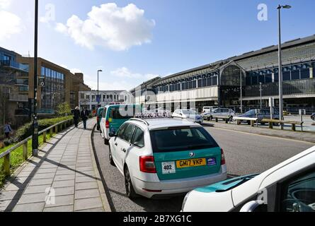 Taxis parked at the back of Brighton Railway Station during the Coronavirus COVID-19 pandemic crisis UK