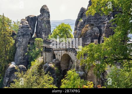 The Bastei bridge in Lohmen in the Elbe Sandstone Mountains, Saxon Switzerland - Stock Photo