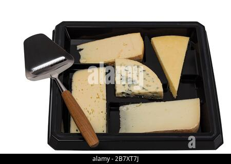 Close up view of different kinds of cheese with cheese knife isolated on black board. Healthy food concept. - Stock Photo