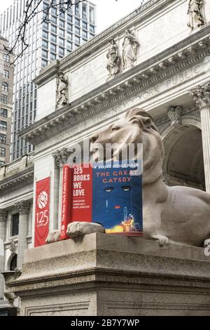 Lion Statue with Book Celebrates 125 Years, New York Public Library, Main Branch, NYC - Stock Photo