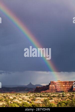 A rainbow over South Six-Shooter Peak in South Eastern Utah as seen from Canyonlands National Park after a rain storm, USA. Stock Photo