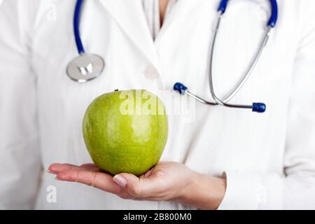 Doctor and green apple - Stock Photo