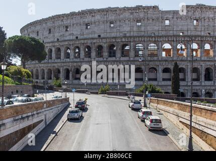 Following the coronavirus outbreak, the italian Government has decided for a massive curfew. Here the usually crowded Colosseum - Stock Photo